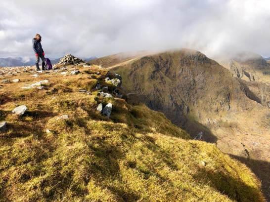 Summit of Carn Ghluasaid, the summit of Sgurr nan Conbhairean shrouded in cloud